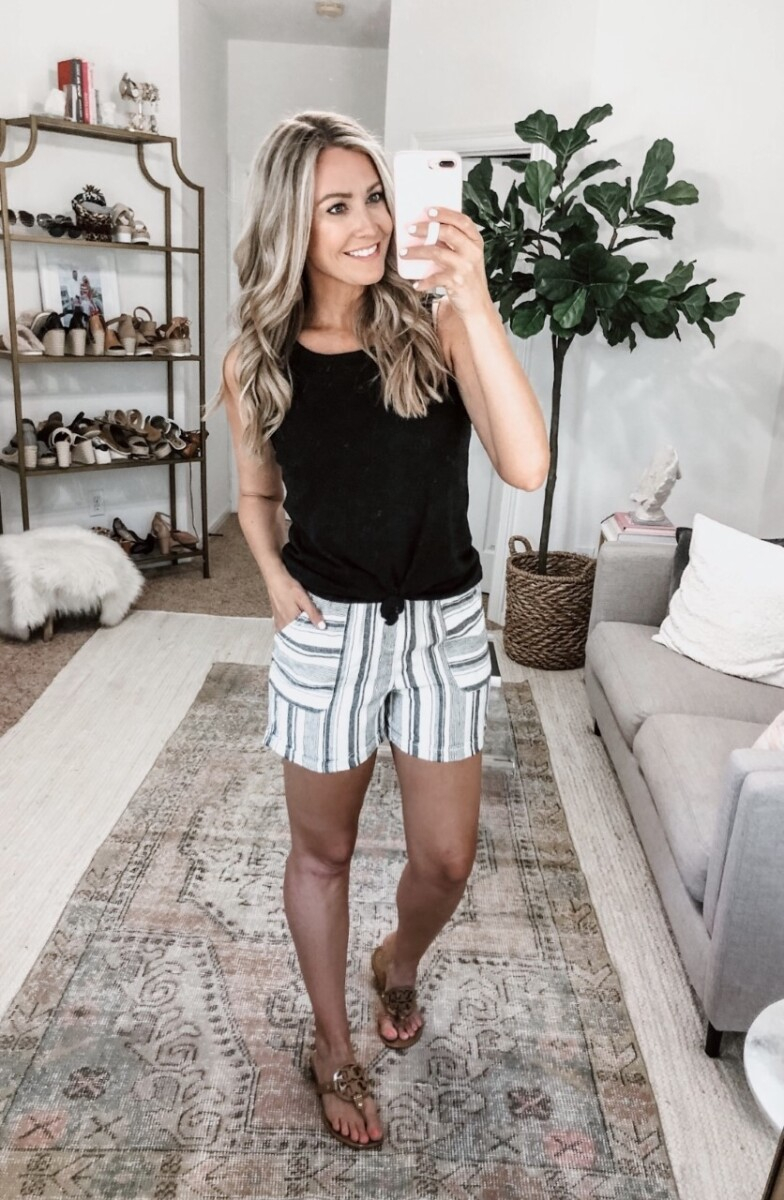 striped shorts | Summer Style by popular Houston fashion blog, Haute and Humid: image of a woman sitting outside and wearing a Walmart Time and Tru Women's Linen Shorts and Walmart Time and Tru Women's Sleeveless Henley Tank Top.
