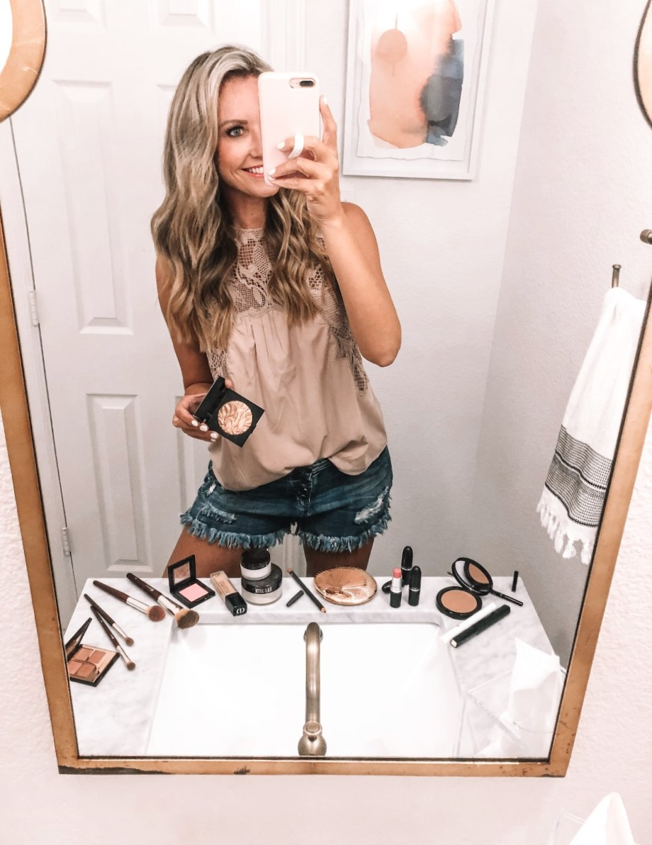 nordstrom makeup | Nordstrom Beauty by popular Houston beauty blog, Haute and Humid: image of a woman standing in her bathroom next to various Nordstrom beauty products.
