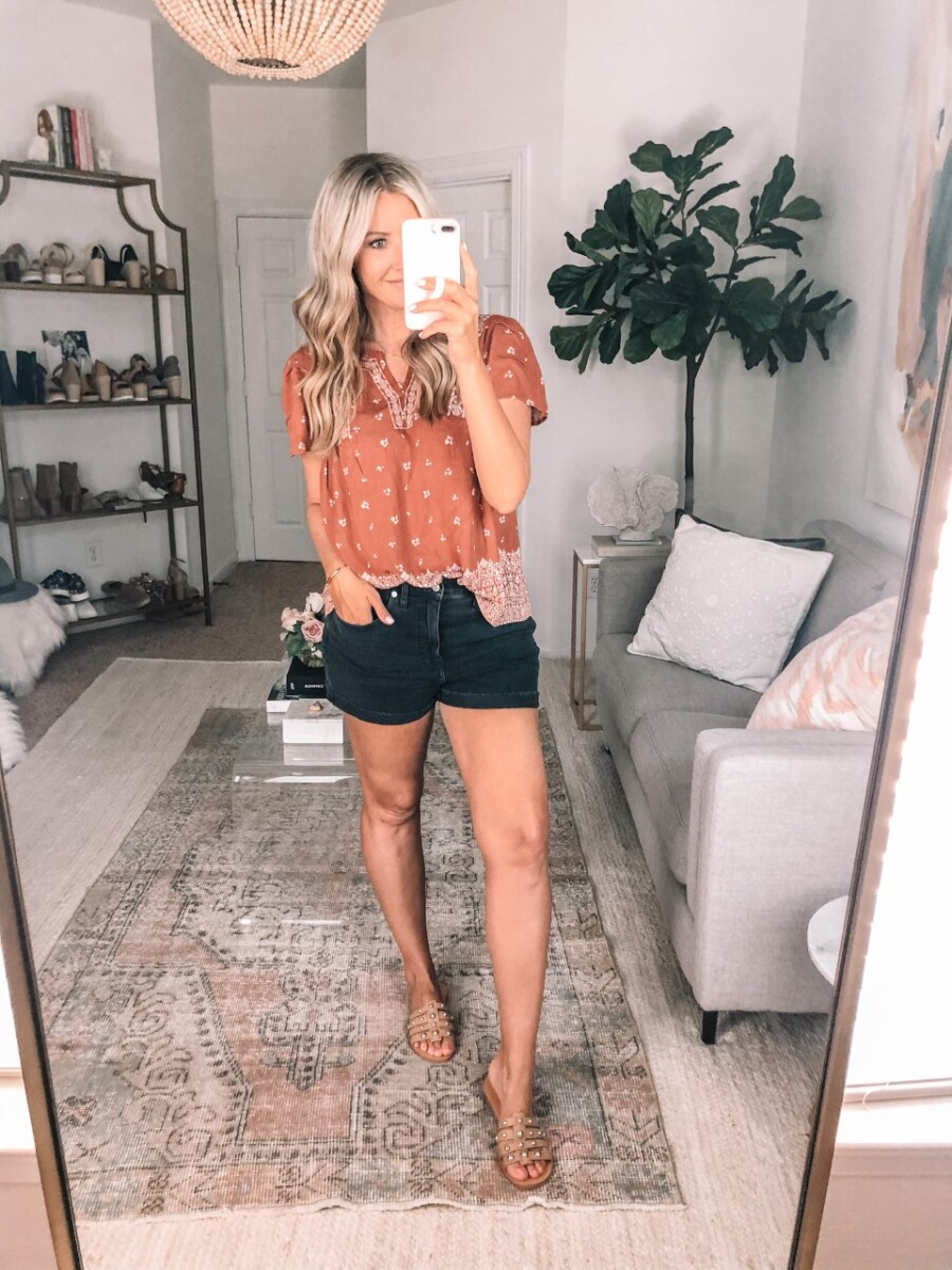 target outfits | Summer to Fall by popular Houston fashion blog, Haute and Humid: image of a woman wearing a Target Knox Rose Women's Floral Print Short Sleeve Embroidered Top, Madewell High-Rise Denim Shorts in Lunar Wash: Raw-Hem Edition, and Nordstrom Pava Slide Sandal MARC FISHER LTD.