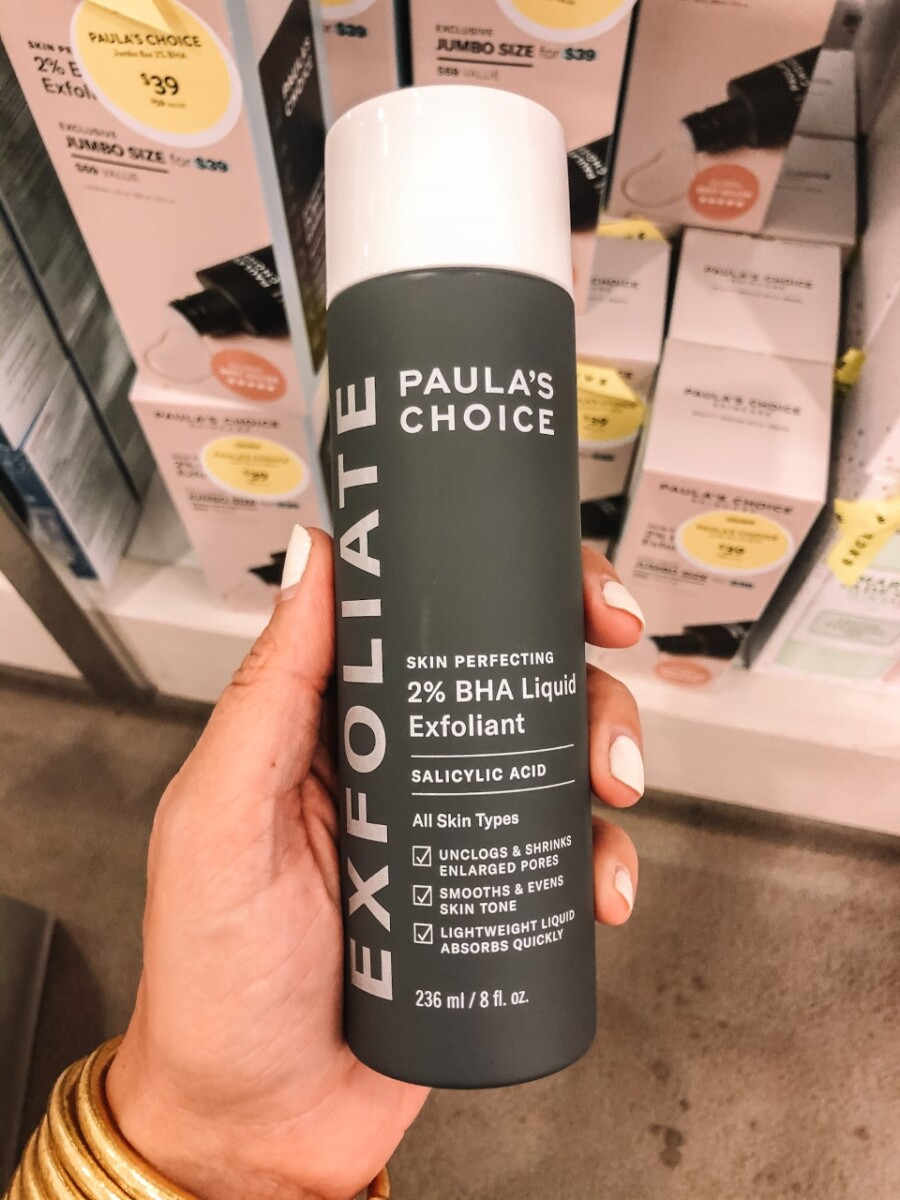paulas choice | Nordstrom Anniversary Sale by popular Houston beauty blog, Haute and Humid: image of a woman holding Paula's Choice exfoliate.