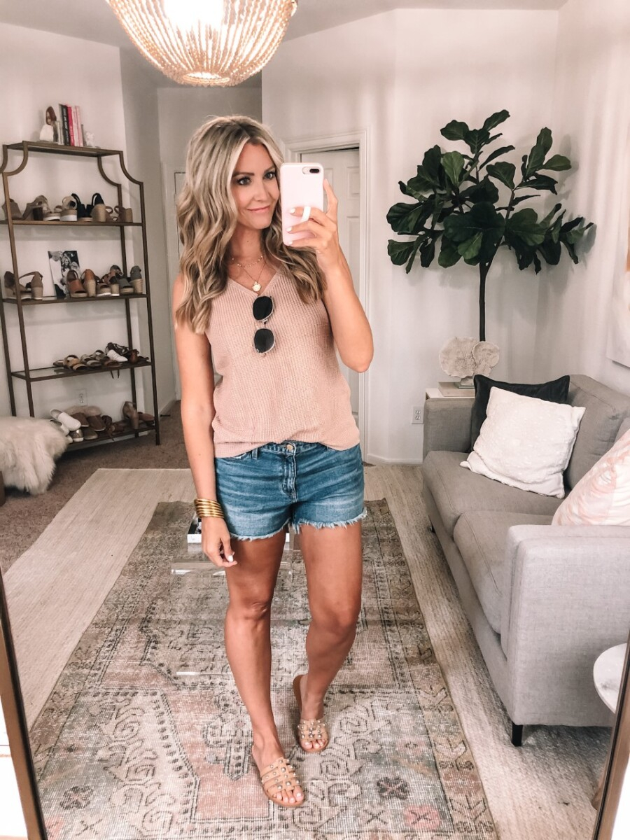 amazon finds under $50 | Best Amazon Products by popular Houston life and style blog: image of a woman wearing a knit tank, denim shorts, and slide sandals.