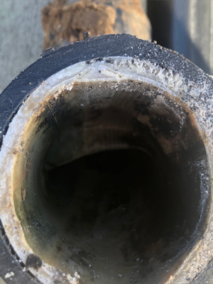Clean cut of main line sewer repair by Family Plumbing, Heating & Air, Inc.