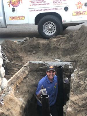 Brian Berck during sewer main line repair by Family Plumbing, Heating & Air, Inc.
