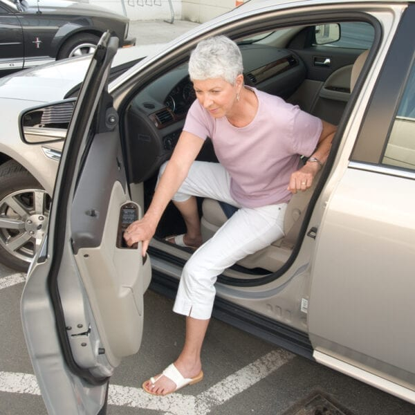 Stander Swivel Seat Cushion used by an old woman
