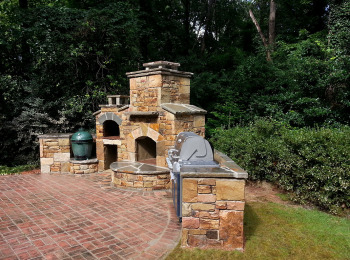 Belgard Paver Patio with Fireplace, Grill and Green Egg Stone Nest