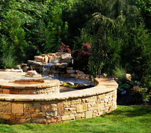 Flagstone Patio With Sittling Wall, Fire Pit and Waterfall