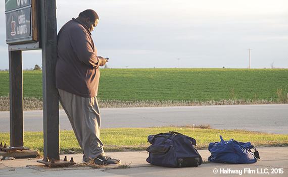 Quinton as Byron on the set of Halfway, waiting at Mills Market in Montfort, Wisconsin. © Halfway Film LLC, 2015