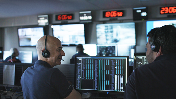 Jeff Bezos tests communication systems before the first flight of the New Shepard space vehicle. Photo credit: Blue Origin