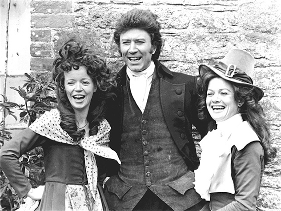 Robin Ellis as Ross Poldark (center), with Angharad Rees as Demelza Carne (left) and Judy Geeson as Caroline Penvenen (right) in the original Poldark series, c. 1975. Photo credit: BBC