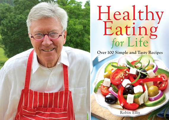 Left: Robin in his red apron. Right: Robin's second cookbook. Photos credit: Meredith Wheeler