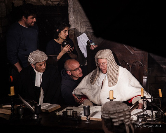 Director Ed Bazalgette (crouching with glasses) confers with Robin before the scene is filmed. Photo credit: Nick Kenyon