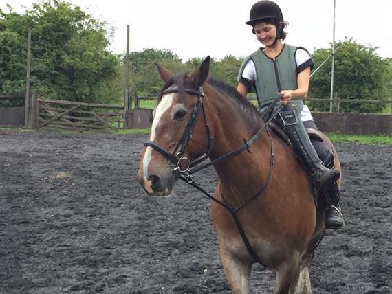 Ruby practicing her horseback riding for Poldark.