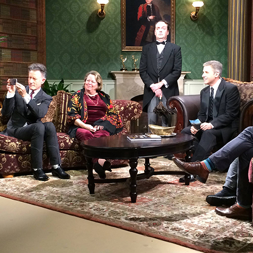 Mr. Rodgers looks on with the others as Lyle Lovett, a guest on the first episode of Manor of Speaking this season, captures the moment on his phone.