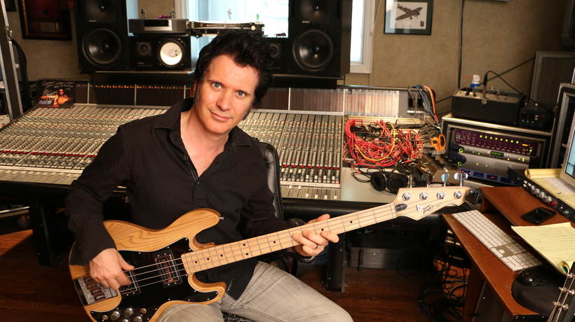 Warren in his studio on bass guitar, one of seemingly dozens of instruments on which he is a master! Photo: Kasia Huart