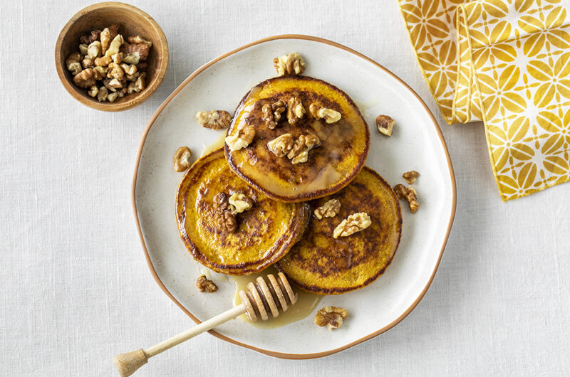 Healthy spiced pumpkin oatmeal pancakes with ginger honey.