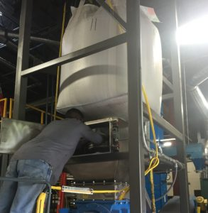 REDUCING DUST IN BULK BAG UNLOADER