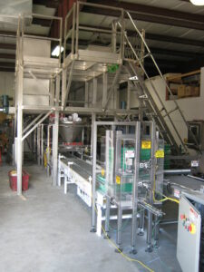 denesting section of minor ingredient batching system