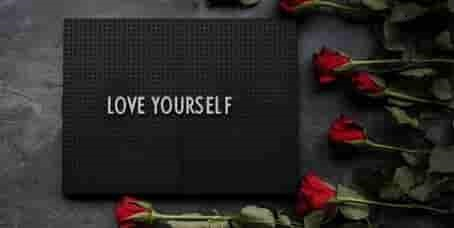 'Love Yourself' title on book with roses on one side