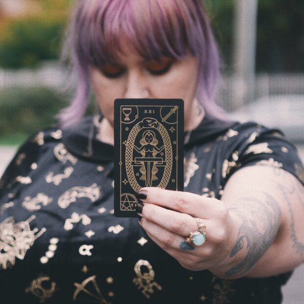 Margot holding her Golden Thread Tarot