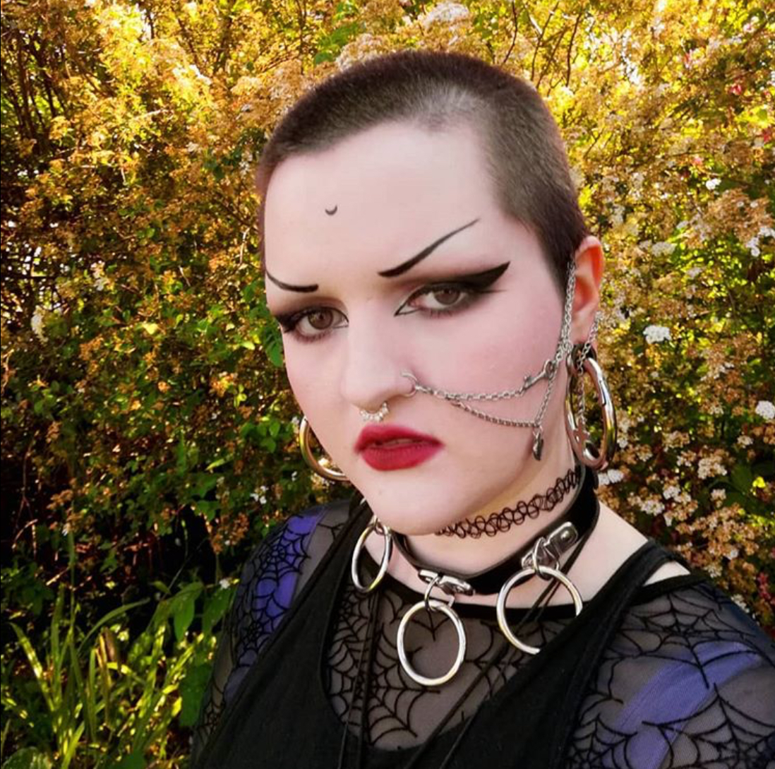Goth Portrait with buzzed head and chain jewelry