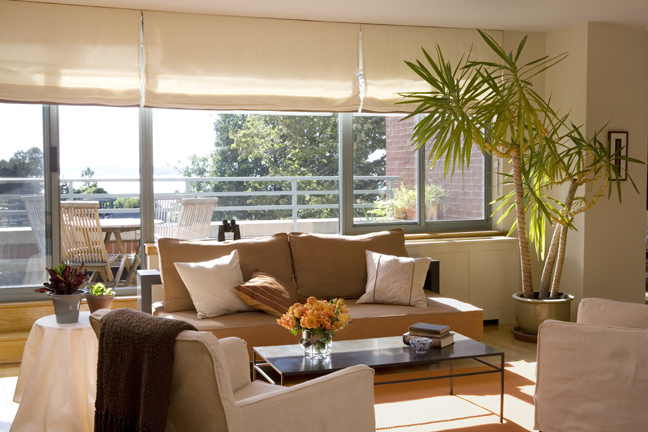 Rooms with fresh flowers and open views help sell homes