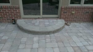 Brick paver patio and step by Twin Oaks Landscaping