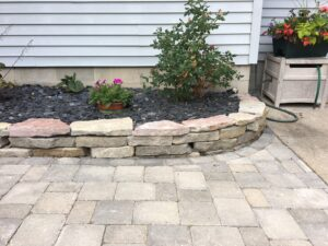 brick pavers and natural stone raised bed