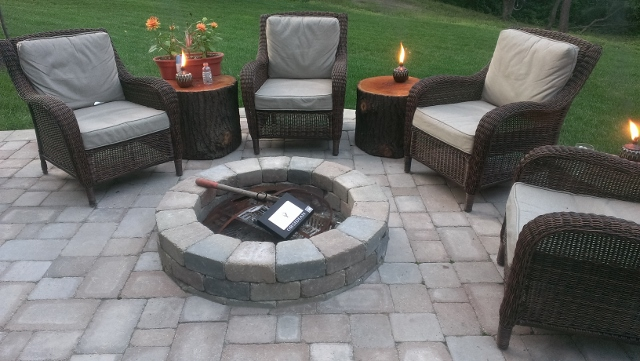 outdoor living paver fireplace and patio