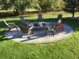 Outdoor living space brick paver patio and firepit
