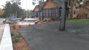 Landscaping with shredded mulch by Twin Oaks Landscaping