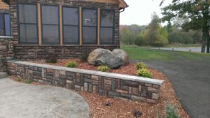 Landscaping with boulder accent by Twin Oaks Landscaping