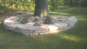 Outcropping stone bedline by Twin Oaks Landscaping