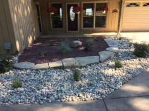 Raised bed with natural stone by Twin Oaks Landscaping