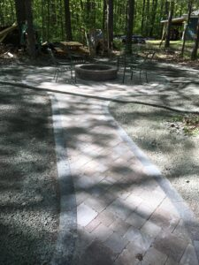 Brick paver outdoor living space by Twin Oaks Lanscaping