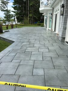 Brick paver outdoor living space by Twin Oaks Landscaping