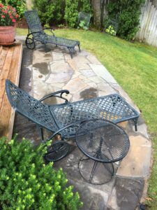 Natural stone patio and outdoor living space by Twin Oaks Landscaping