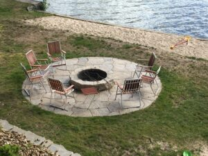 Brick paver firepit by Twin Oaks Landscaping