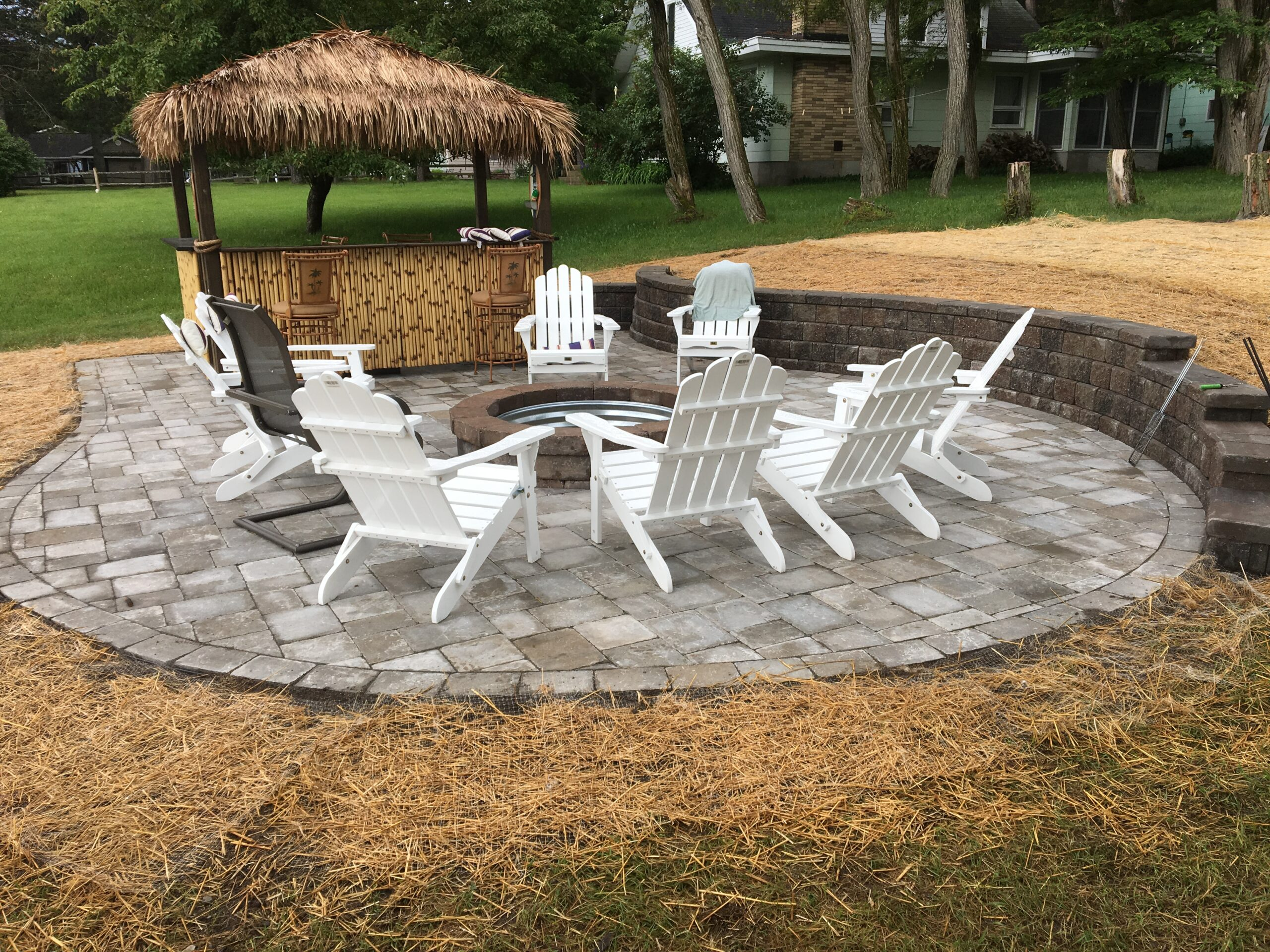 Brick paver firepit and outdoor living space by Twin Oaks Landscaping