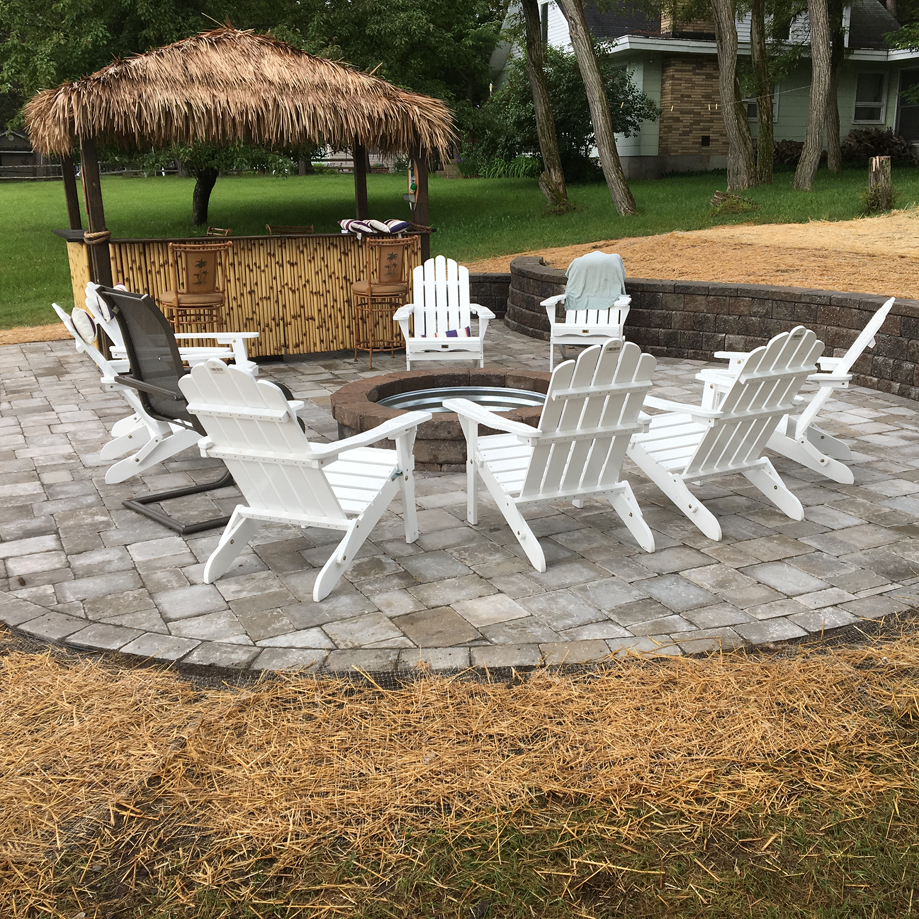 Outdoor living paver patio and fireplace