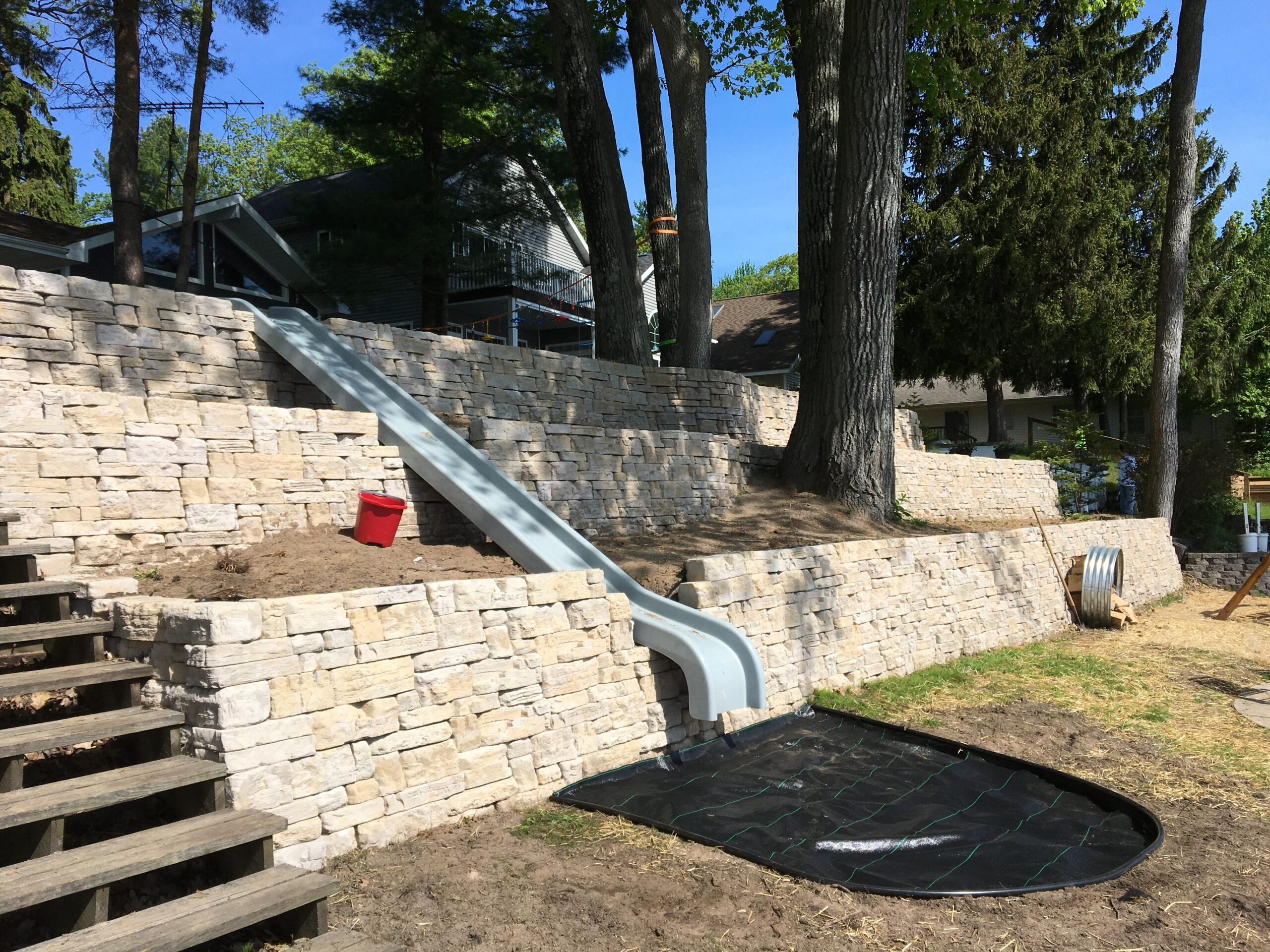 Tri-level Retaining wall with slide by Twin Oaks Landscaping