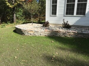 Natural stone softscape with retaining wall by Twin Oaks Landscaping