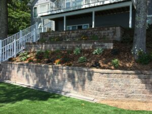 Retaining wall and softscape design by Twin Oaks Landscaping