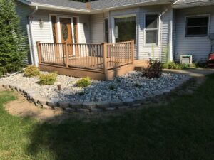 Natural stone softscape and retaining wall by Twin Oaks Landscaping