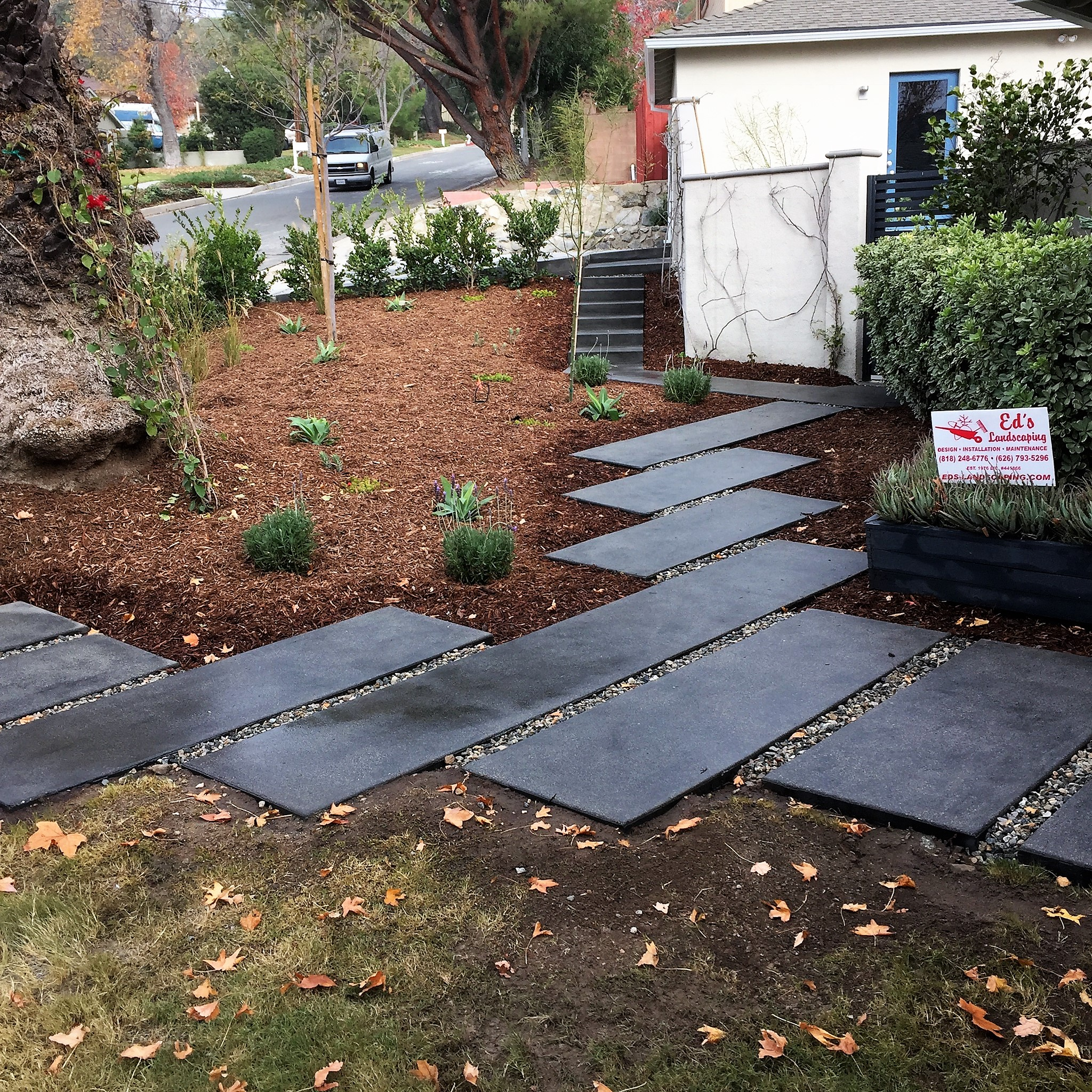 Ed's Landscaping Completed black cement walkway project