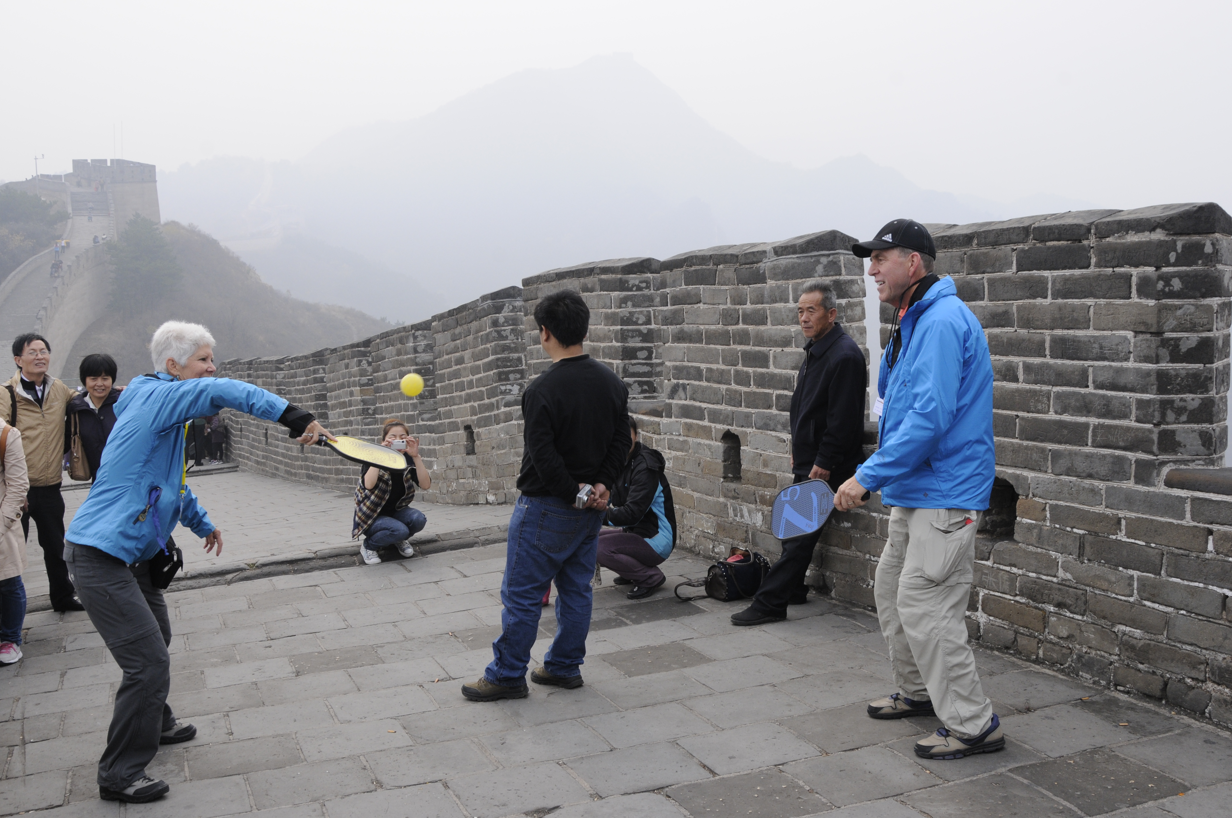 "Connie & Bob Anderson ""playing"" pickleball on the Great Wall."