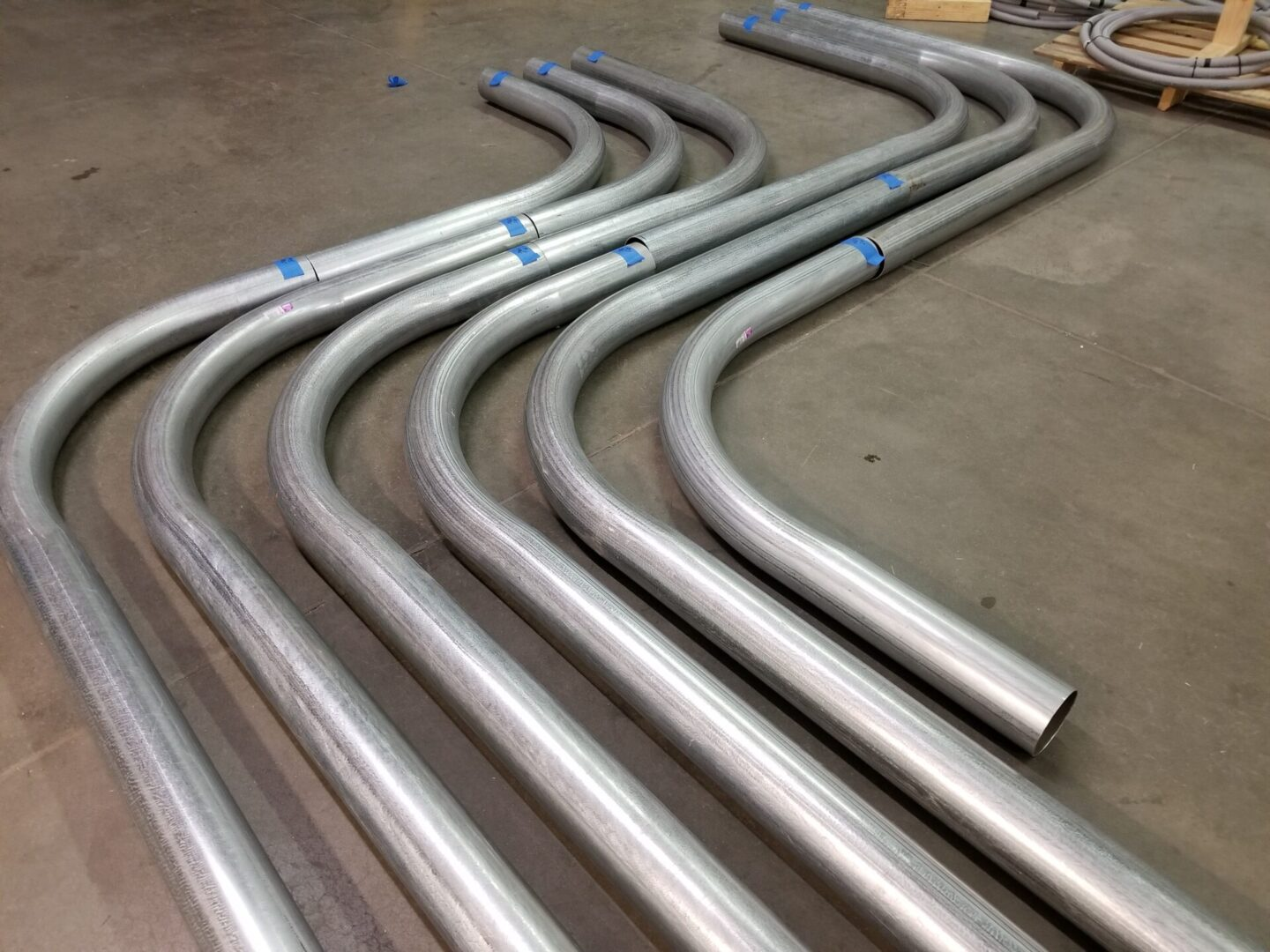 Curved metal pipes