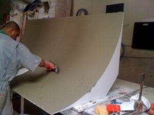 Man coating a cyclorama wall