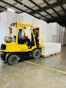 Yellow forklift carrying cyclorama walls