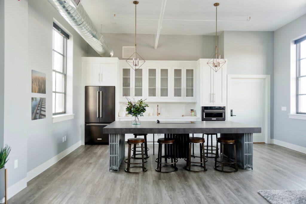 Modern White Kitchen with Grey Wood Style Vinyl Flooring