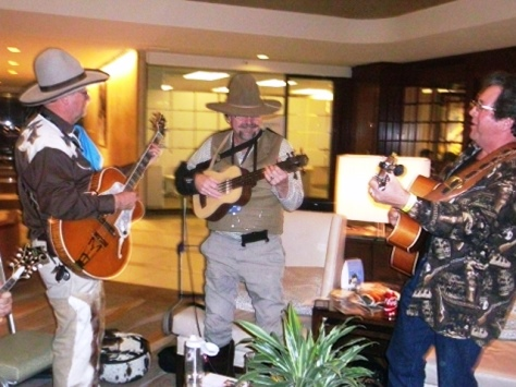 Members of the 3 Trails West Cowboy Band from Wyandotte County played in the lobby of a Kansas City, Mo., hotel during the Folk Alliance International conference this week. (Photo by William Crum)